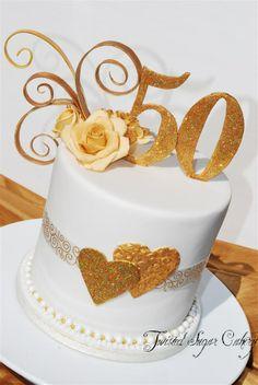 Anniversary - 50th wedding anniversary.  Gumpaste decorations.