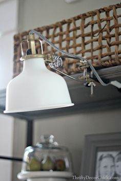Ranarp clamp lamp with non-LED bulb, black and white cord