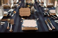 Great striped table clothes add a little something extra to these elegant tables.    Photo:  Liga Photography