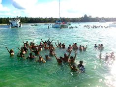 All our happy clients in the natural pool. A naturally shallow area right in the middle of the ocean where we bring the drinks and the fruits right into the water. #naturalpool #swimming #puntacana http://puntacanaexpert.com/water-activities-in-punta-cana