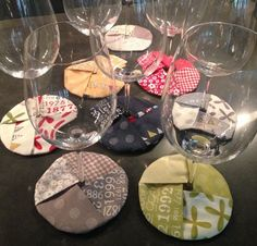 wine coasters - your glass is recognisable and wherever you put it down it is on a coaster!