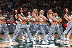 "The Milwaukee Bucks dance team performs during the ""90s night"" game against the Golden State Warriors on March 28, 2015 at BMO Harris Bradley Center in Milwaukee, Wisconsin.  (Photo by Gary Dineen/NBAE via Getty Images)"