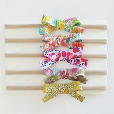 Liberty of London floral print baby bow headbands or hair clips nylon headband elastic headband by LondonandLulu on Etsy https://www.etsy.com/listing/385432758/liberty-of-london-floral-print-baby-bow