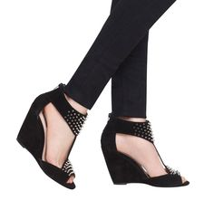 Spiked t-strap wedges.