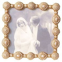 Jewel-inspired ivory picture frame.   Product: Picture frameConstruction Material: Metal and glassColor: IvoryAccommodates: Holds one 3.5 x 3.5 photoDimensions: 4 H x 4 W x 0.75 D