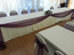 Dark Purple Organza top table swagging with chair covers and sashes at Washingborough Community Centre.