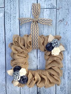 Do you love the look of burlap but want something a little more unique? Burlap garland is secured around a square wire form then decorated with an