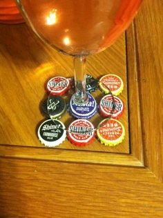 DIY bottle cap coasters. For Ryan's mancave! Would have to put something on the bottom so they don't scratch.