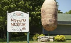"Canada's Coolest Roadside Attractions | ""Prince Edward Island's Giant Potato"" • P.E.I. is known for its potatoes, which explains why the town of O'Leary is home to both a potato museum and the Giant Potato, a 14-foot tall fibreglass potato statue. (photo courtesy of FiberFarm) 