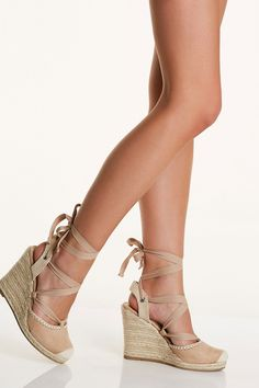 Chic espadrille wedges with soft suede finish and comfortable back strap.  Lace up design with