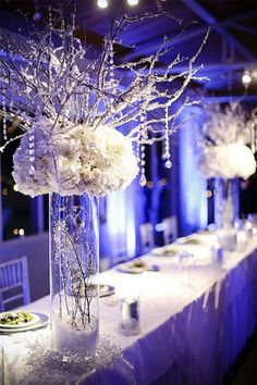 Centerpieces ... Snow-covered branches, a snow-filled vase, and snow-white flowers perfectly reflect the time of year.  Allow me to help you with your Winter Wonder Land at Precious Promises, We love Creating Memories - ItheirasWeddings@aol.com