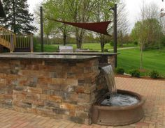 The Site Group's most unique project featuring an outdoor kitchen, water bar and overlook deck. This is a close up of the water bar in action.