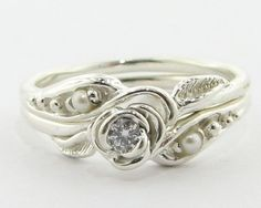 Tea Rose Wedding Set: Diamond with Pearl (I have always said that if someone knows to put a small pearl on my engagement ring is the right guy for me!)