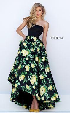 Sherri Hill 50206 is a classic floral princess dress with a fun tea length…
