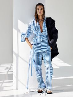 Alessandra Ambrosio models one of the biggest trends from the Fashion Week Spring / Summer 2016 for Glamour US January 2016. From classic navy stripes to bold and thicker stripes, everyone will be dressing for ...