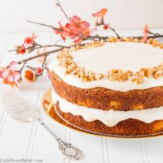 Carrot Cake w Yogurt Cream Cheese Frosting - a tender, moist and perfectly spiced cake, topped with a light silky frosting.