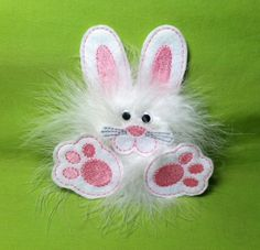 This is my first Machine Embroidery Bunny Feltie....the fluffy body part of the bunny is a piece of Mara Boa. Bunny parts can be purchased from : http://www.buggalena.com/index.php