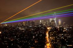 Photos Of The Year 2012 | A 35-Mile Laser Rainbow Illuminates New York As A Memorial To Sandy's Victims  The laser-beamed art project by artist Yvette Mattern is powerful enough to cross from Manhattan to the storm-devastated neighborhoods of Brooklyn and Queens, providing a little hope to still-recovering communities that calm is on the way.