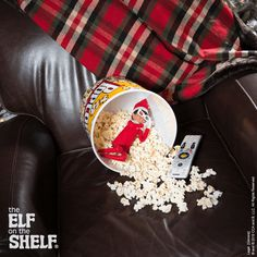 This elf fell asleep while watching a late night movie! | Elf on the Shelf Ideas