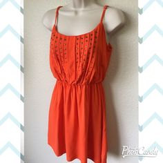 Vibrant orange dress with studded top! So cute and comfy!! Such a beautiful color with studded gold details on the top.. Lightweight with elastic waistline and adjustable spaghetti straps.. Great condition, size medium Dresses Mini