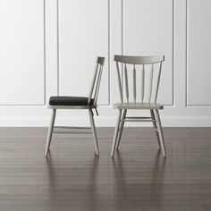 Willa's elegant beechwood frame brings the classic Windsor chair up to date with a slender spindle back, angled legs and subtle saddle seat. <NEWTAG/><ul><li>Designed by Mark Daniel of Slate</li><li>Beechwood frame with dove grey finish and clear lacquer topcoat</li><li>Mortise and tenon joinery</li><li>Polyester foam and fill cushion with 100 percent cotton cover with tie attachments (sold separately)</li><li>Made in multiple countries</li></ul><br />