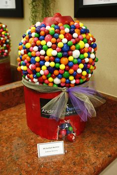 decorated pumpkin - gumball machine. Ask different school organizations to make their own to auction?
