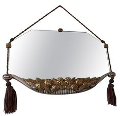 French mirror in the style of Paul Follot, 35 in. wide
