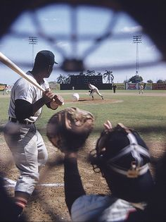 SI's John G. Zimmerman sets up a camera on an umpire's mask during a White Sox spring training practice in 1959. The pitcher is Billy Pierce and the batter is teammate Earl Battey. (John G. Zimmerman/SI)