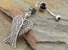Hey, I found this really awesome Etsy listing at http://www.etsy.com/listing/96008605/double-angel-wings-belly-button-ring