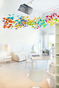 A fluttering swirl of origami butterflies, I love this fusion of design installation and styling by Elixr and Dream Interiors. Created for annual design event Saturday in Design, the butterflies make a striking piece of . Origami Installation, Vitrine Design, Origami Butterfly, Origami Birds, Rainbow Origami, Ceiling Decor, Decor Room, My New Room, Interior Inspiration