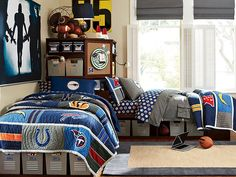 I love the PBteen Store-It NFL Bedroom on pbteen.com nice wall color, window covering, and football art