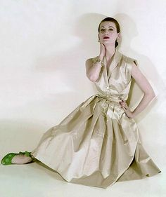 1951 Model in silk shantung dress by Nettie Rosenstein worn with silk shantung pumps adorned with white snowflakes