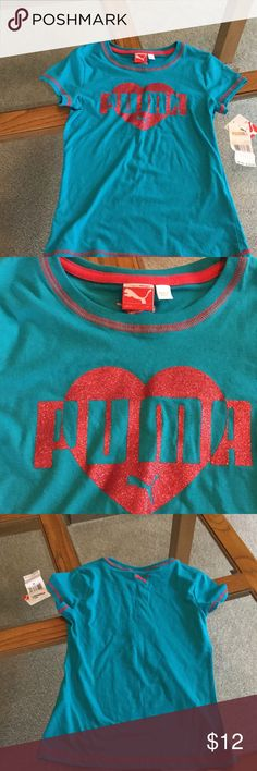 Pump Tee Top NWT blue in color with pink trim and sparkled  puma printed on front.  60% cotton and 40% polyester. Puma Shirts & Tops Tees - Short Sleeve