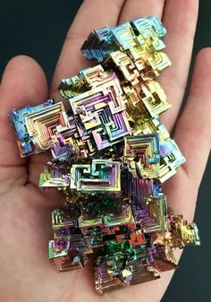 I actually have a necklace with a smaller pics of this crystal. These are bismuth crystals!