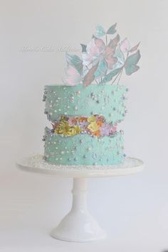 Pastel Flowers and Butterflies Fault Line Cake | 15+ Fault Line Cakes that WOW! Click over to Rose Bakes to see several designs of the trendy Fault Line Cakes that are so popular right now! #faultline #faultlinecakes #cake #faultlinecake #cakes #genderreveal #baby #babycakes  #butterflies