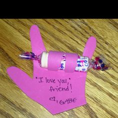 """Homemade Valentine's card - sign language """"I love you"""" sign with Smartie candy tucked under fingers"""