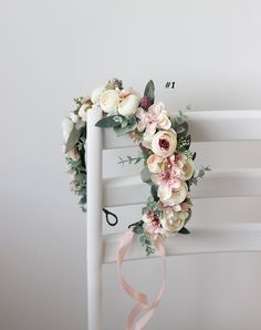 Flower crown is decorated with fabric flowers and plastic and fabric greenery . Details ------------------------------------------------------------------------ Flower crown created without use of glue ------------------------------------------------------------------------- -Length of