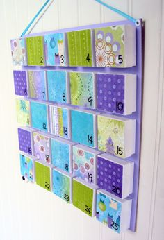 advent calendar... using little white jewelry gift boxes - DIY with different wrapping papers glued to lid.