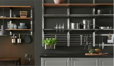 The open shelves in stainless steel and ash venner of the KUNGSFORS series of wall-mounted kitchen storage will give your kitchen more professional functionality.