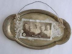 Use a vintage tarnished silver tray as a picture frame.
