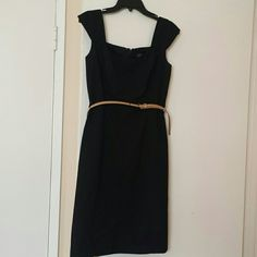 Tahari Arthur S. Levine Petite Dress Sophisticated black Tahari dress. Back zipper and back bottom slid. Black lining. You can add your own style belt to dress for a party or for work. Like new. Tahari Dresses