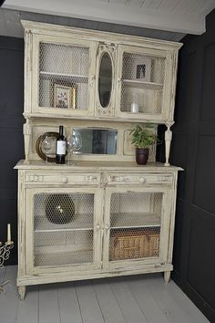 My mom has one of these on the side of her house. Think we should make hers look like this one! French Shabby Chic Kitchen Dresser with Chicken Wir…