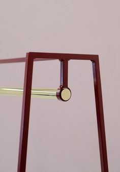Beetroot A powder coated clothes rail with solid  brass pole