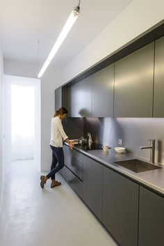 Ajuda Apartment is a residential project recently completed by Portuguese studio Arriba. Black Kitchen Decor, Grey Kitchen Designs, Kitchen Design Open, Luxury Kitchen Design, Contemporary Kitchen Design, Kitchen Cabinet Design, Home Decor Kitchen, Kitchen Furniture, Kitchen Interior