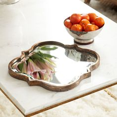 Arabesque Mirror - Wisteria.com Coppery brass, shown flat for size perspective.  Accent mirror $79