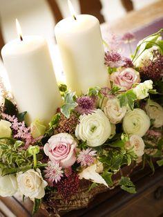 Wedding flower arrangement with candles