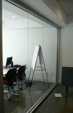 Semi-frameless Glass wall.