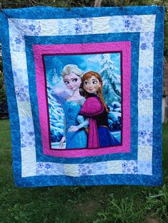 Childs Elsa and Anna Quilt  58 X 66 inches  Beautiful panel quilt surrounded by snowflake fabric with a blue and white scroll accent and backing