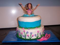 Barbie swimming pool cake - I'm not sure who originally did this cake.  I was given a picture of this to do.
