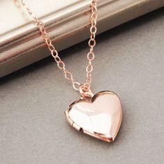 A shiny rose gold plated heart locket with an American made 16K rose gold filled chain. Longer chain lengths available.  This classic heart locket